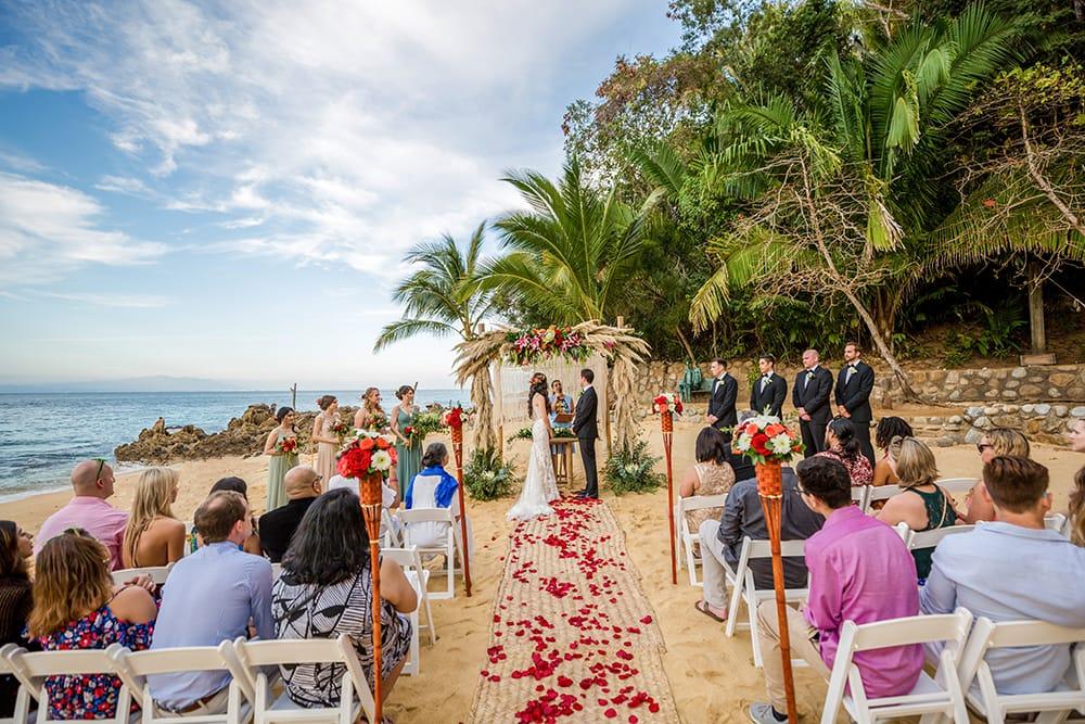 Stunning beach wedding ceremony during destination wedding coordinated by Adventure Weddings