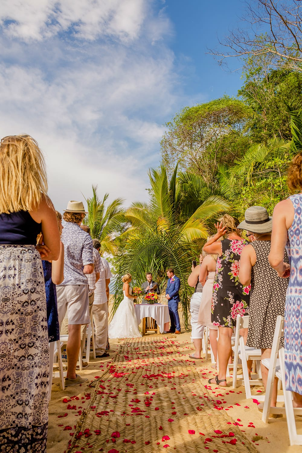 Simple wedding ceremony on the beach during destination wedding coordinated by Adventure Weddings