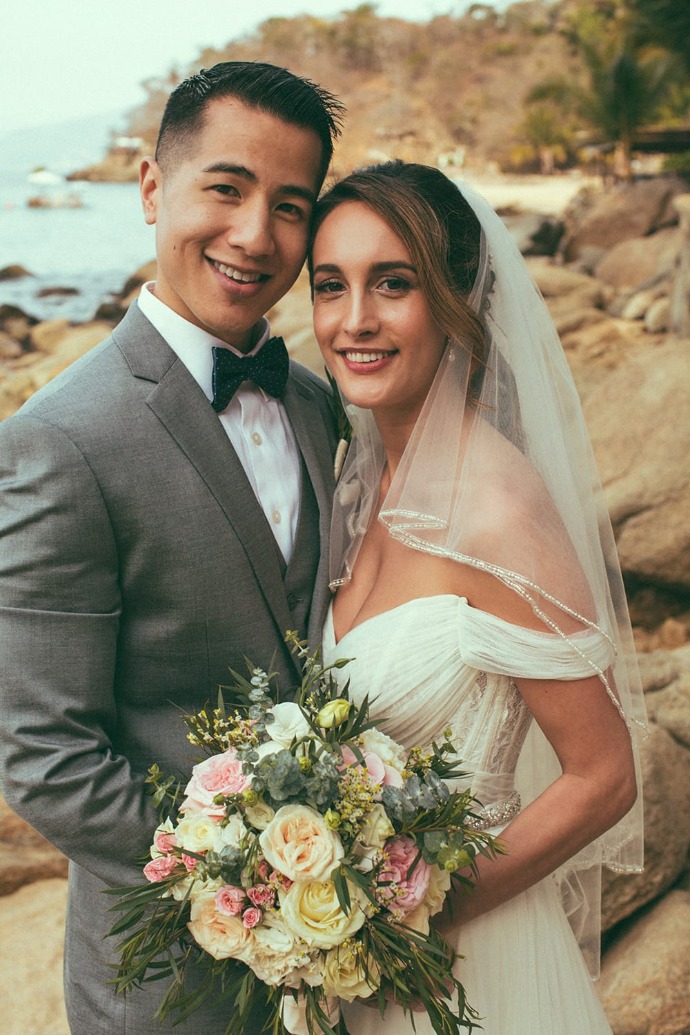 Bride and groom smiling after their first look at Adventure Weddings private beach venue
