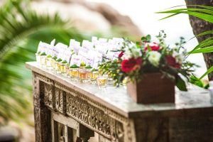 Tequila shots for guests of Mexico destination wedding on top an ornate table decorated by Adventure Weddings