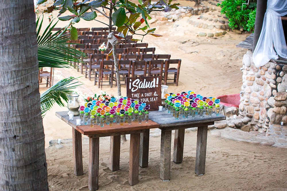 Unique seating chart and wedding favour of tequila shots for destination wedding in Mexico coordinated by Adventure Weddings