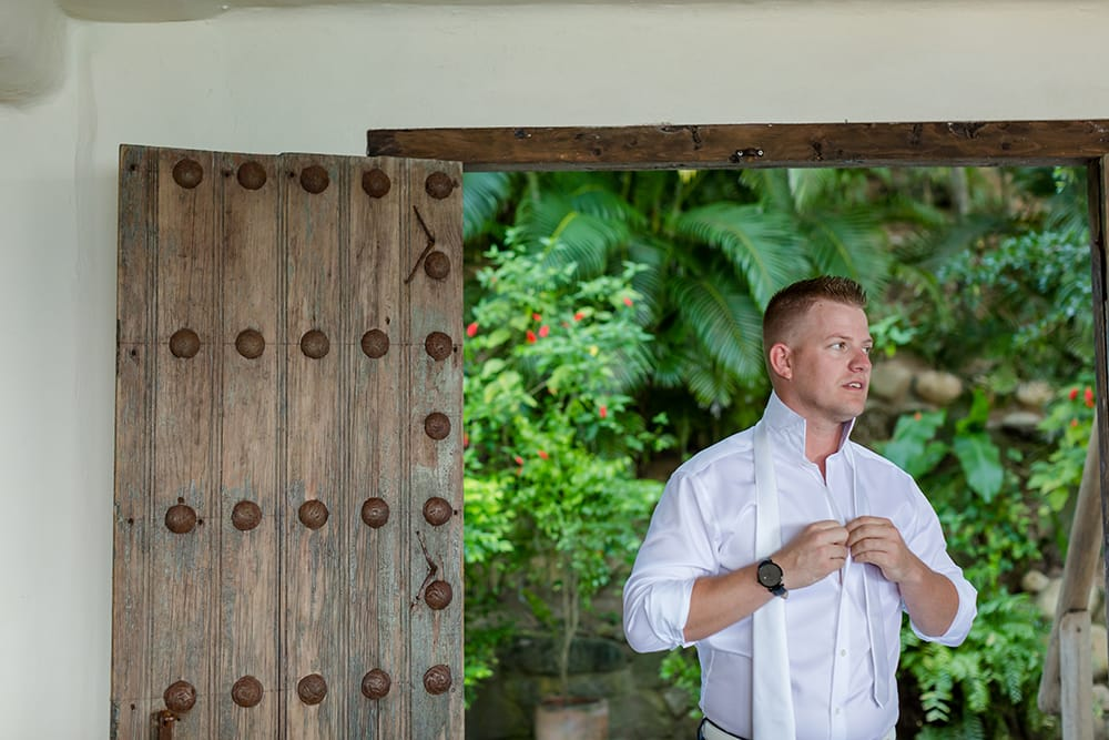 Groom getting ready for his wedding in Adventure Weddings private suite