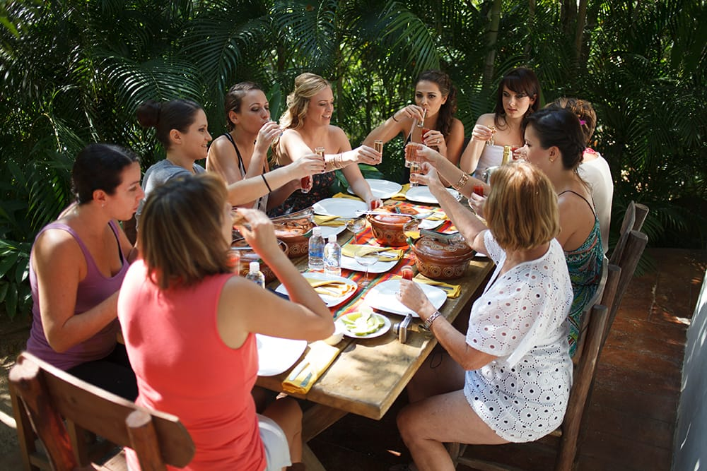 Bride enjoys lunch with her bridal party prior to the wedding ceremony in Mexico on outdoor patio space attached to the getting ready suite.