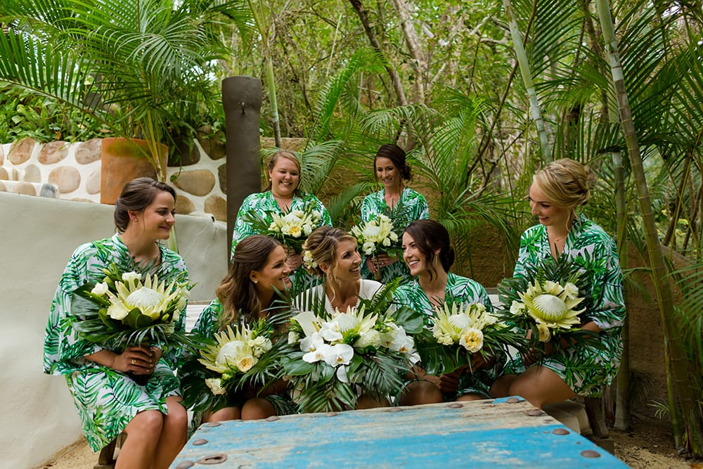 Bride and bridesmaid enjoy the outdoor patio space while getting ready for the wedding at Adventure Weddings private venue