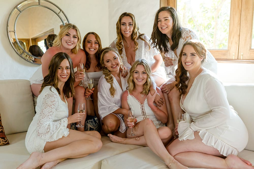 Bride and bridesmaids relaxing in Adventures Wedding bridal suite prior to her ceremony