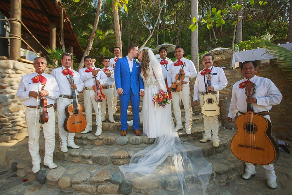 Mariachi band with bride and groom at destination wedding by Adventure Weddings