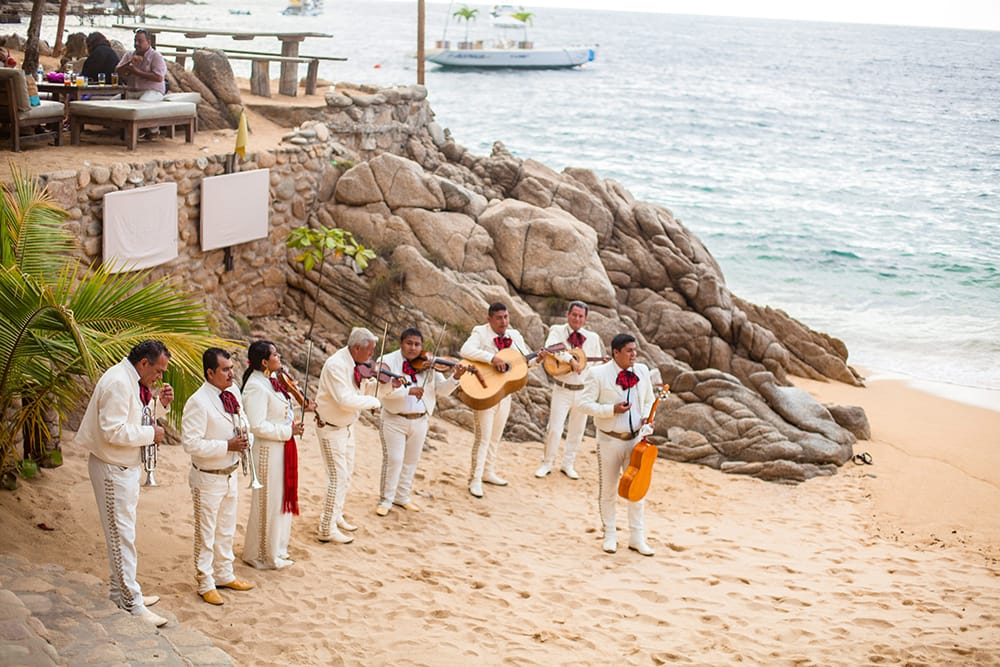 Live mariachi band at beach wedding ceremony by Adventure Weddings