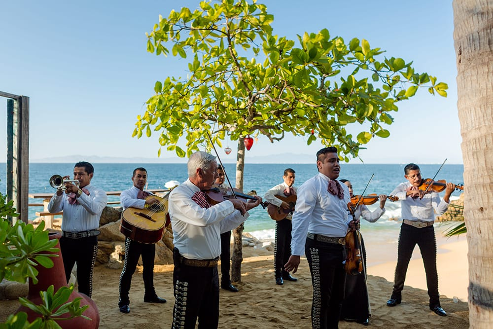Mariachi band playing for beach wedding reception - Adventure Weddings