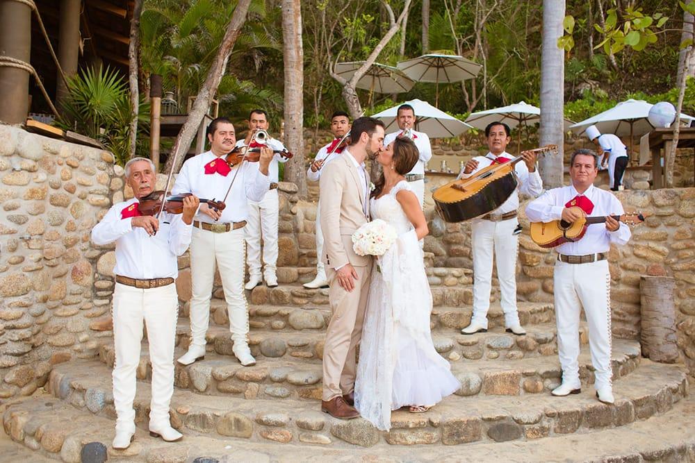 Mariachi band serenades bride and groom at destination wedding by Adventure Weddings