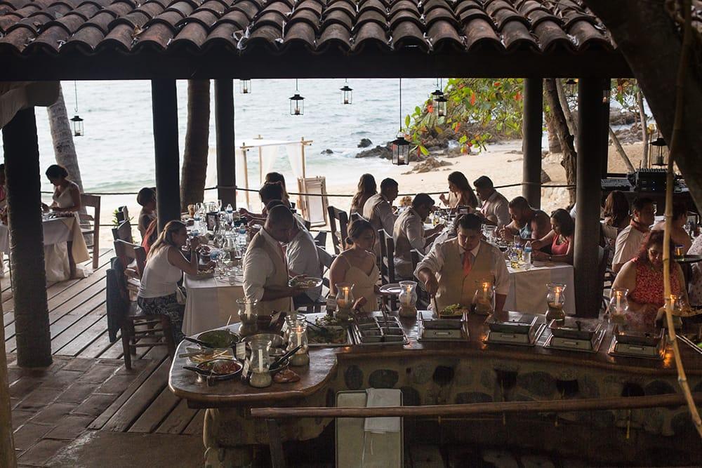 Bridal party enjoying warm buffet service at destination wedding in Mexico by Adventure Weddings