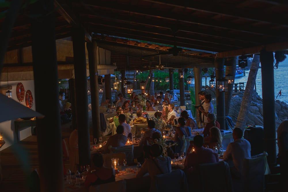 Sunset candlelit dinner destination wedding reception by Adventure Weddings