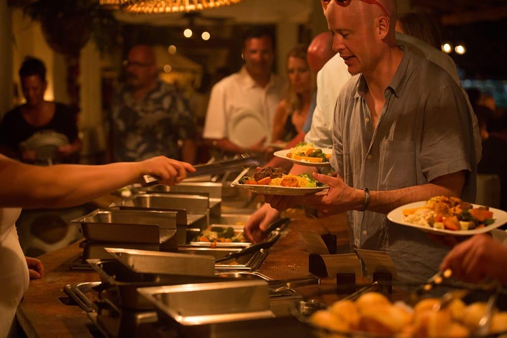 Full hot buffet dinner service at destination wedding by Adventure Weddings