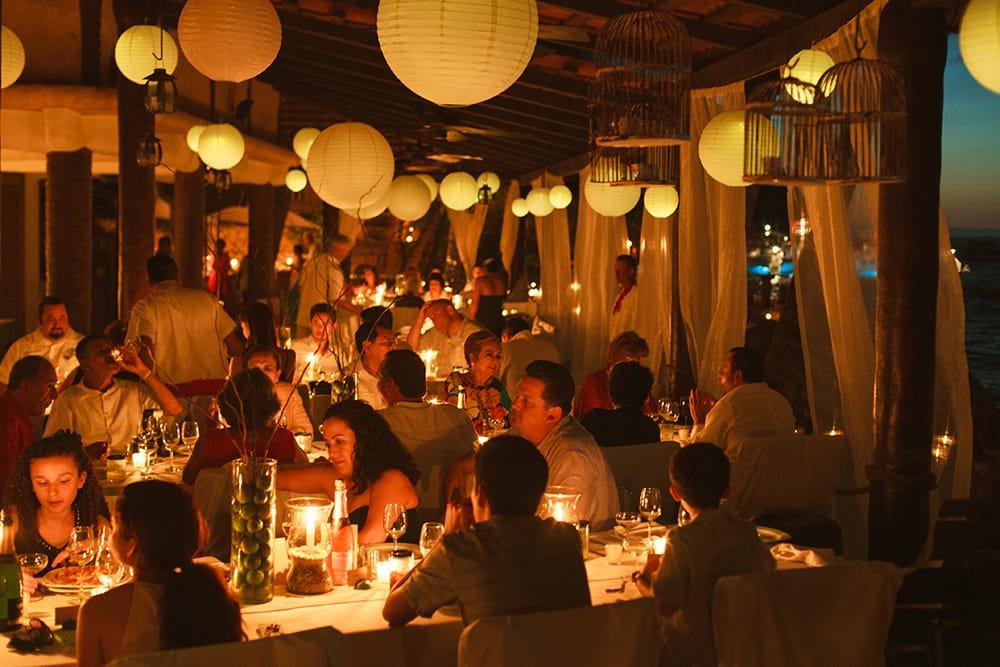 Evening destination wedding reception lit by chinese paper lanterns