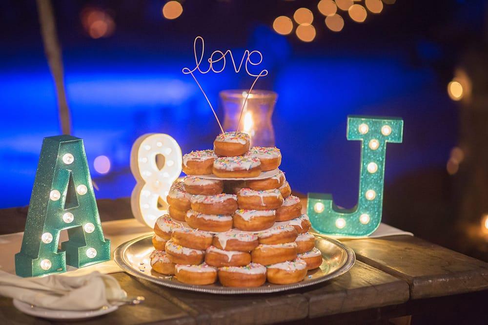 Donut wedding cake at destination wedding by Adventure Weddings