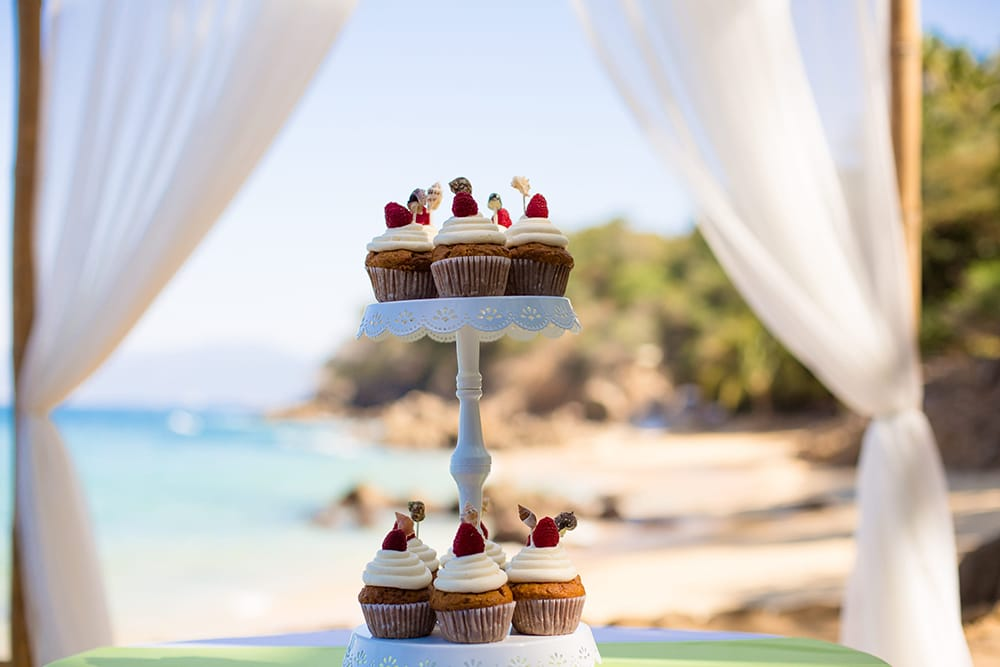 Cupcakes on cake stand for outdoor beach wedding by Adventure Weddings