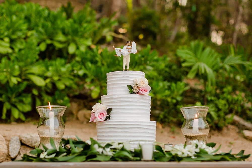 Classic three tiered wedding cake with bride & groom cake topper by Adventure Weddings
