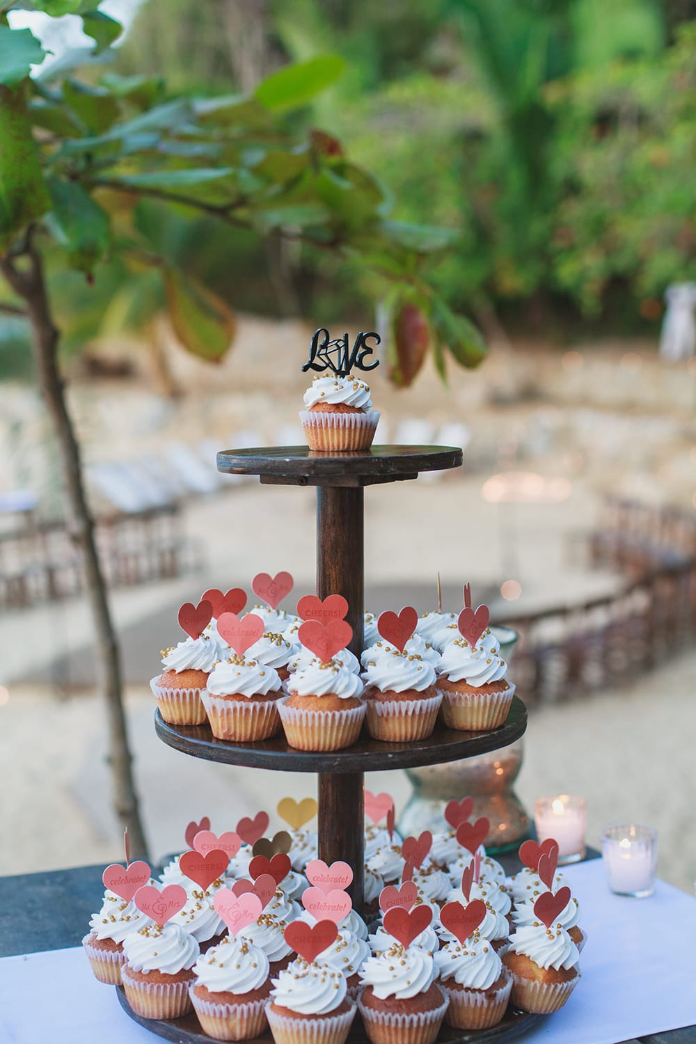 Sweet cupcakes on cake stand for outdoor wedding reception by Adventure Weddings