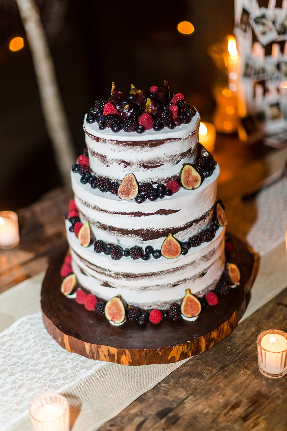 Three tiered rustic wedding cake with fruit by Adventure Weddings
