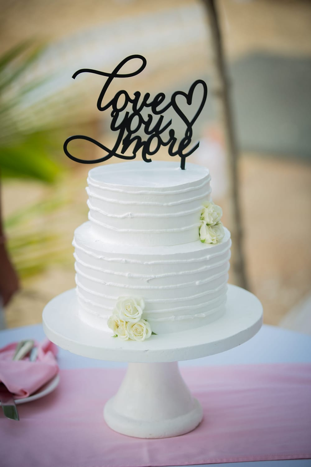 Traditional white wedding cake with cake topper by Adventure Weddings