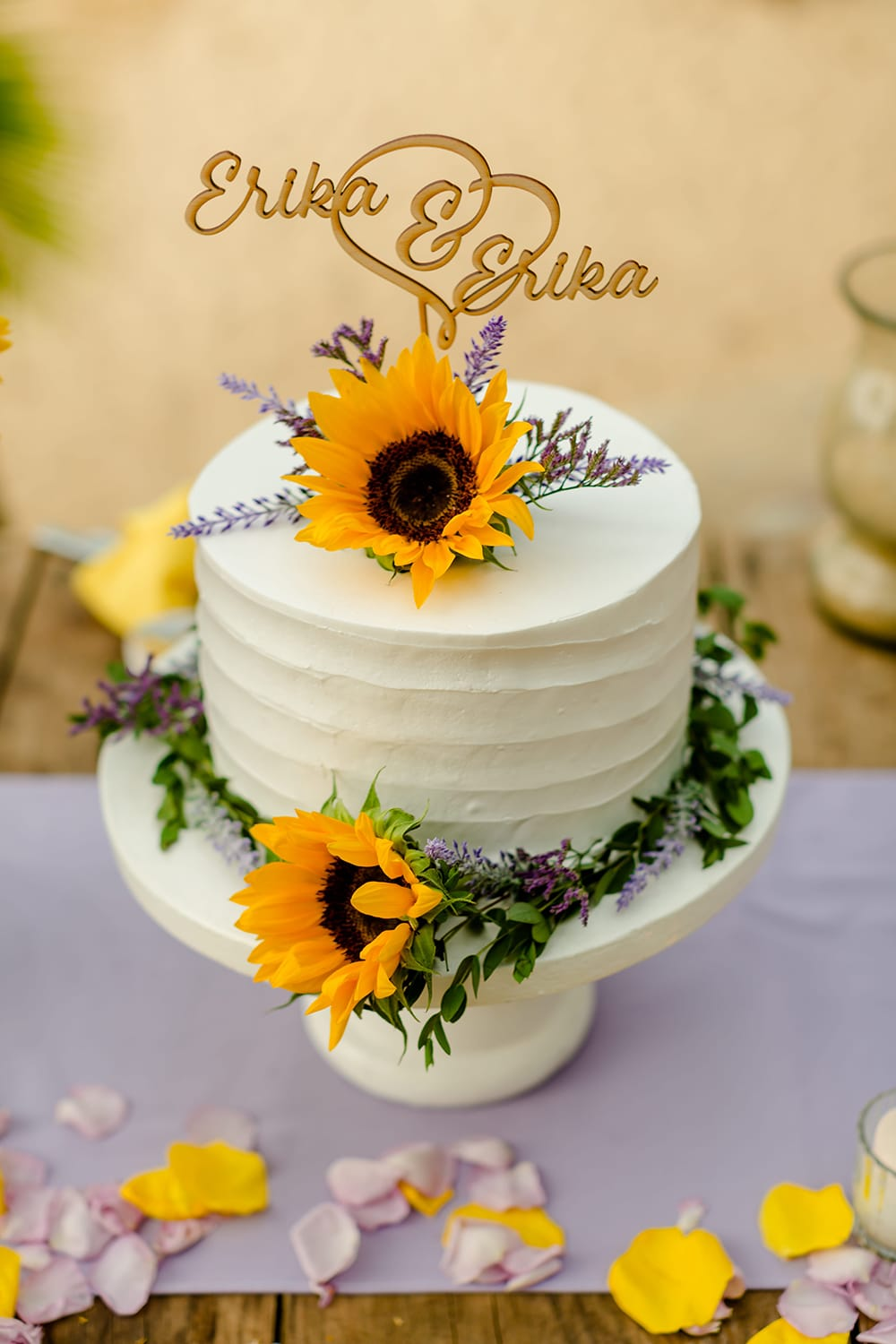 Single tiered buttercream wedding cake with sunflowers by Adventure Weddings