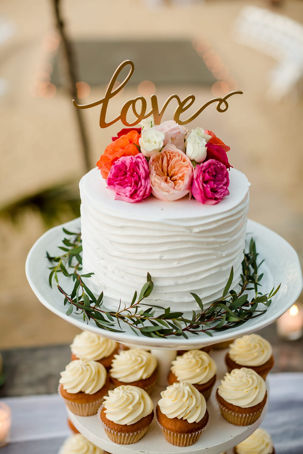 Cutting cake with cupcakes for destination wedding by Adventure Weddings