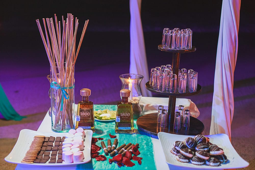 Smores bar, tequila shots and rolled cigars as wedding favours for destination wedding in Mexico coordinated by Adventure Weddings
