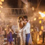 Wedding guests waving sparklers during couples first dance at their destination wedding coordinated by Adventure Weddings