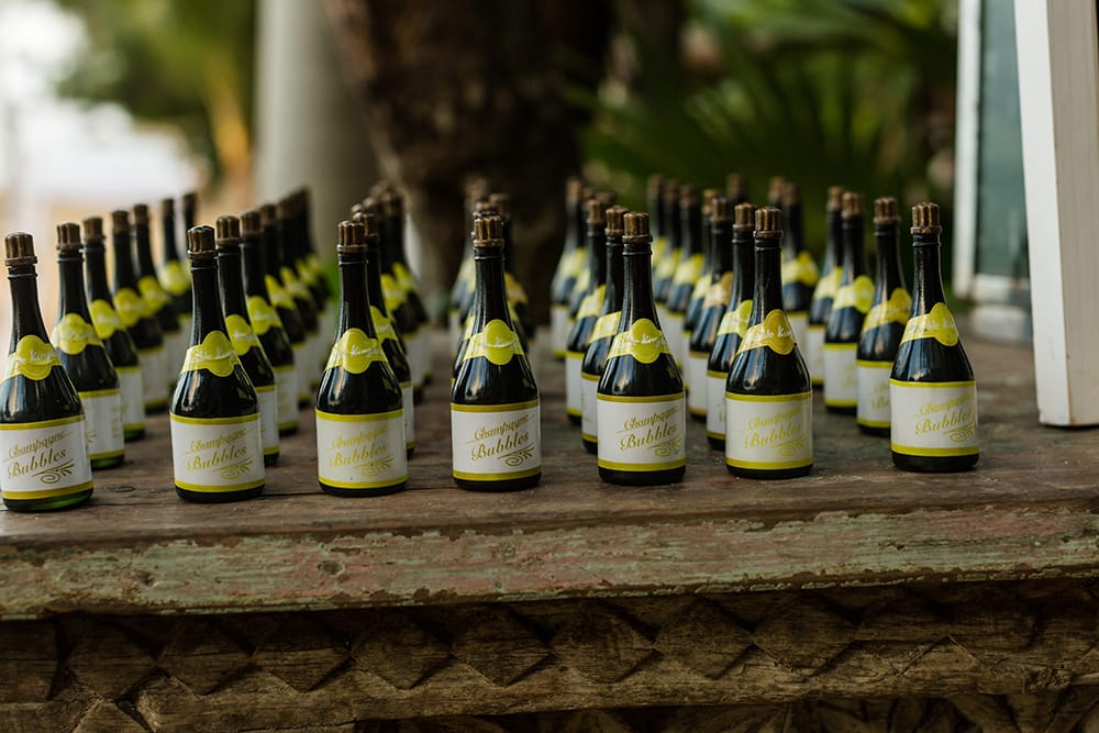 Individual bottles of champagne for wedding favours at a destination wedding in Mexico