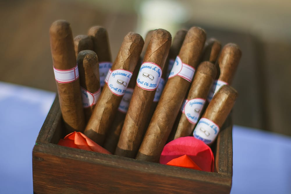 Cigar rolling station at Mexico destination wedding as favours for guests - coordinated