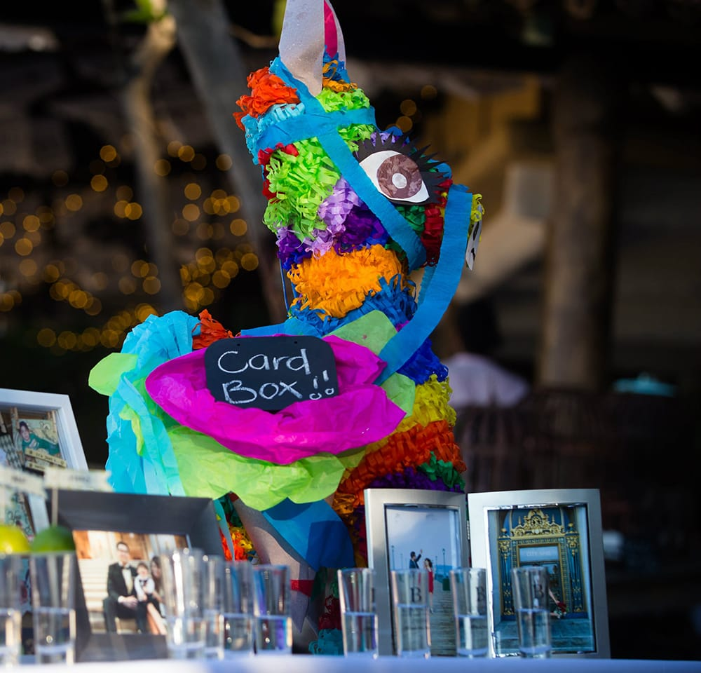 Colorful pinata card box for destination wedding in Mexico coordinated by Adventure Weddings