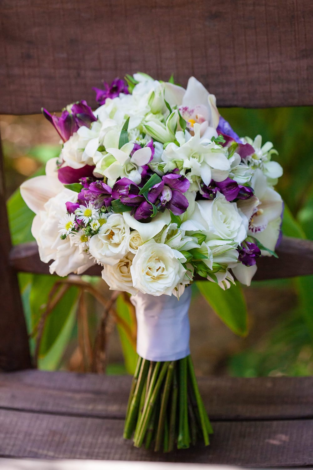 White and purple wedding bouquet for a beach wedding by Adventure Weddings' destination wedding florist