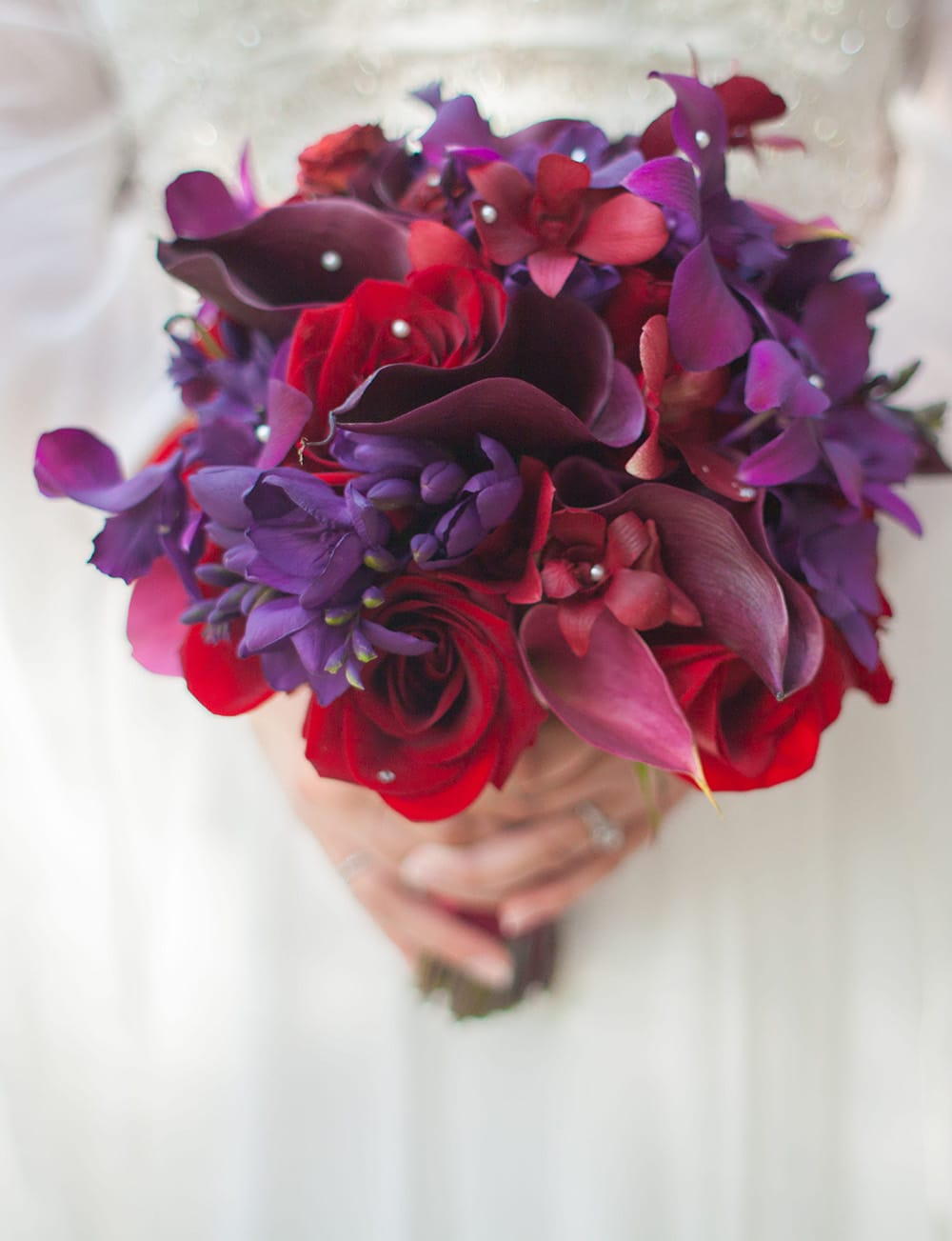 Purple and red wedding bouquet by Adventure Weddings' destination wedding florist