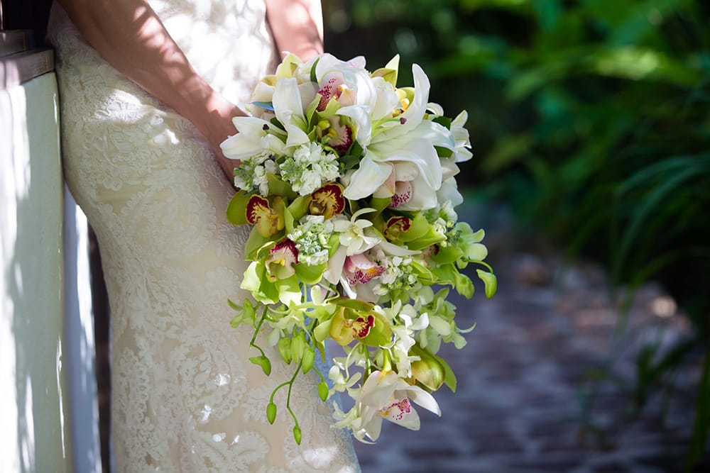 Tropical lily waterfall wedding bouquet by Adventure Weddings' destination wedding florist