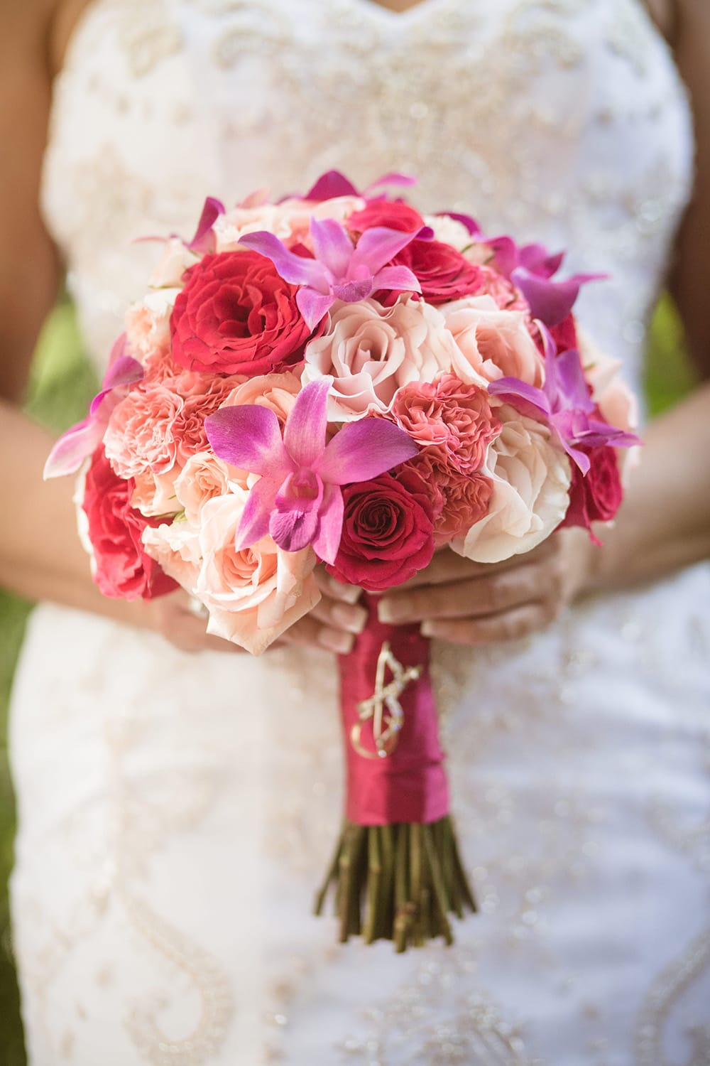 Vibrant pink wedding bouquet for tropical beach ceremony by Adventure Weddings' destination wedding florist