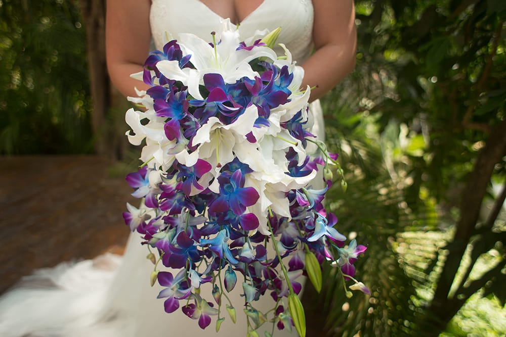 Stunning waterfall wedding bouquet for beach ceremony by Adventure Weddings' destination wedding florist