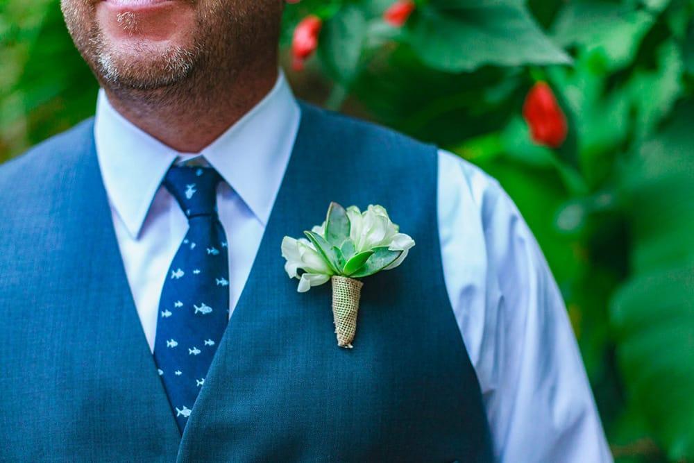 Simple white groomsmen boutonniere by Adventure Weddings' destination wedding florist