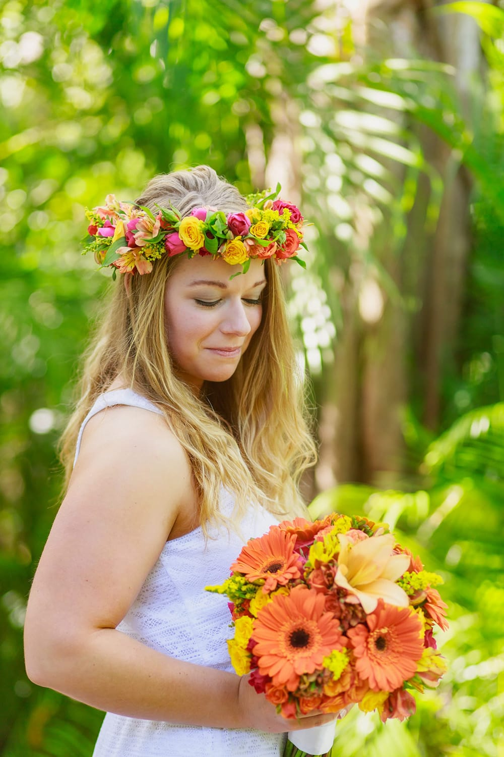 Tropical and colourful flower crown and bouquet for bride at her beach wedding designed by Adventure Weddings' florist