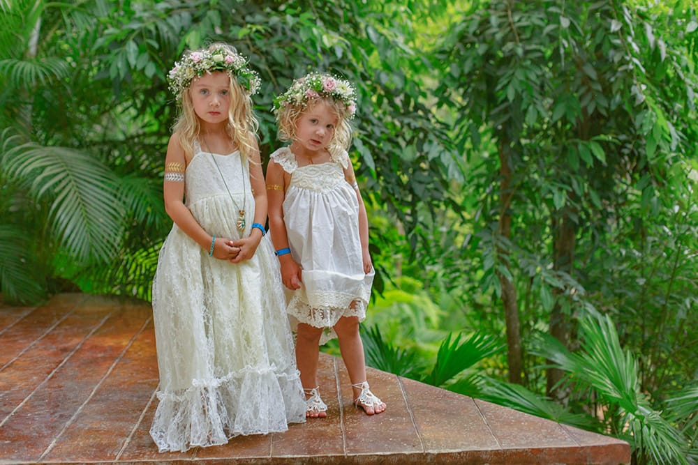 Flower girls at destination wedding with bohemian style flower crowns designed by Adventure Weddings' florist