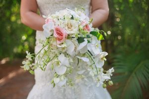 Waterfall wedding bouquet with pink and white roses by Adventure Weddings' destination wedding florist