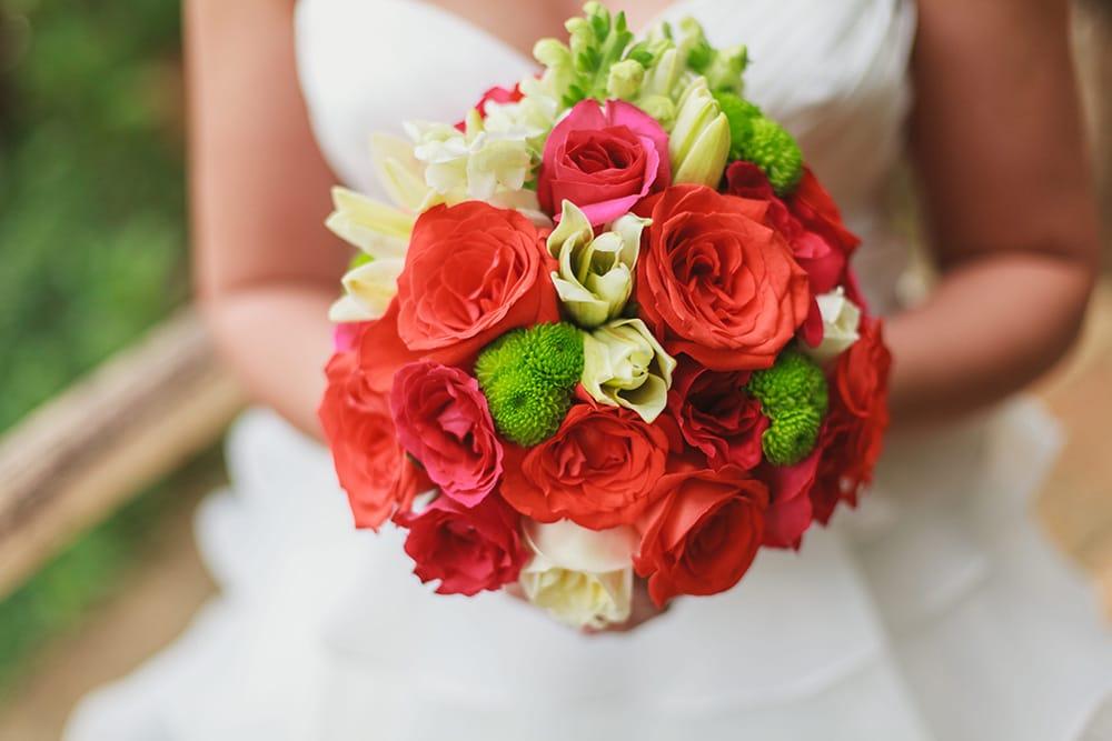 Vibrant orange rose bouquet for a bride by Adventure Weddings' destination wedding florist