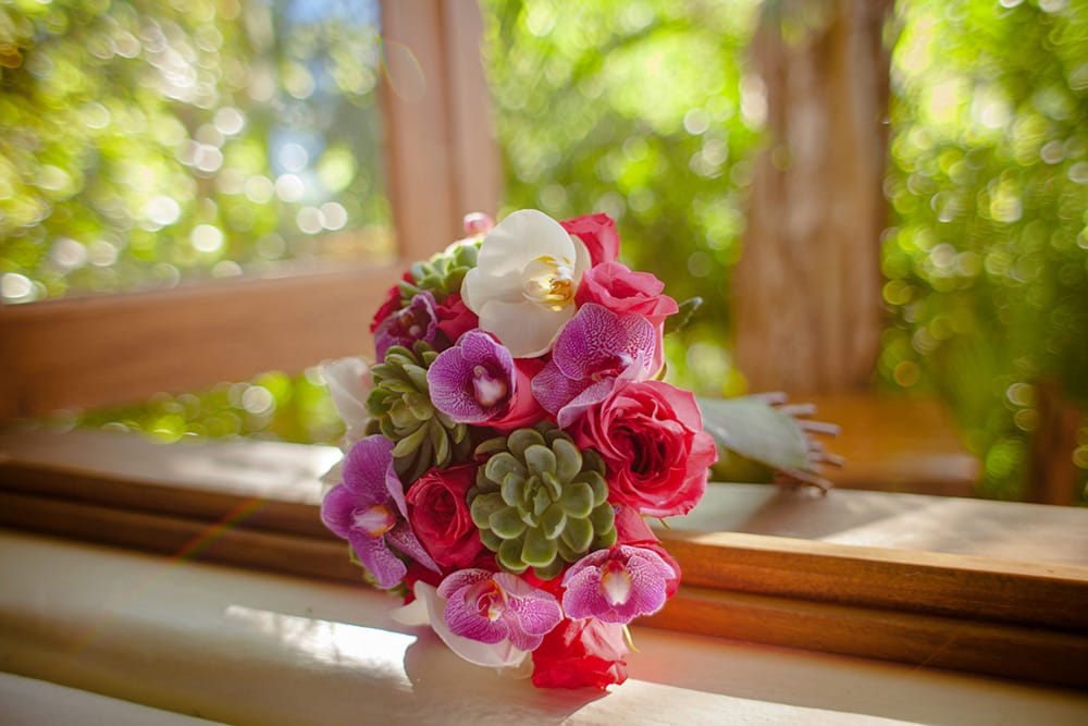 Pink wedding bouquet with succulent accents by Adventure Weddings' destination wedding florist