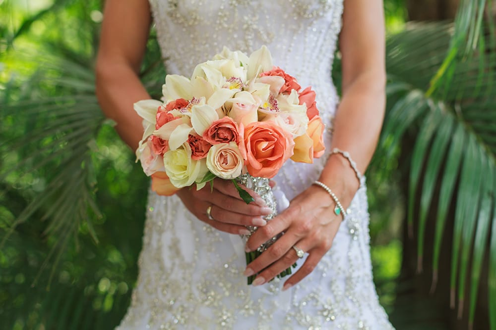 Simple rose and lily bridal bouquet by Adventure Weddings' destination wedding florist