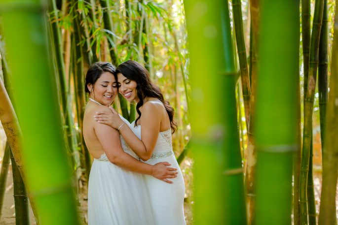 Two brides sharing an intimate moment at their destination wedding with Adventure Weddings in Mexico