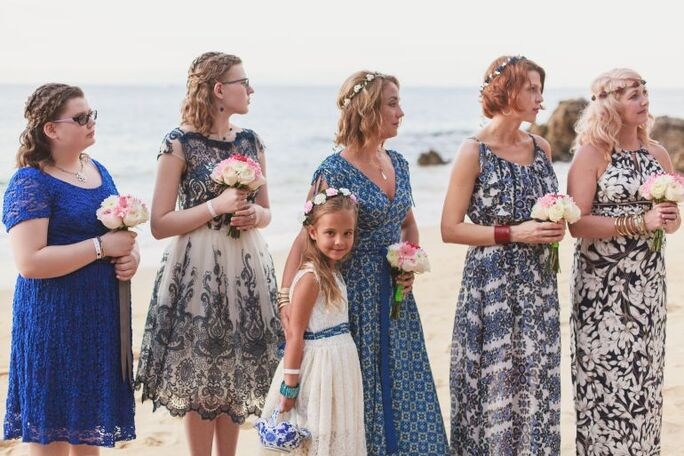 Bridesmaids in mixed and matched sundresses for casual beach wedding with Adventure Weddings