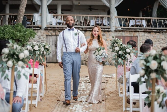 Maid of Honour and Best Man walking down the aisle at formal beach wedding hosted by Adventure Weddings