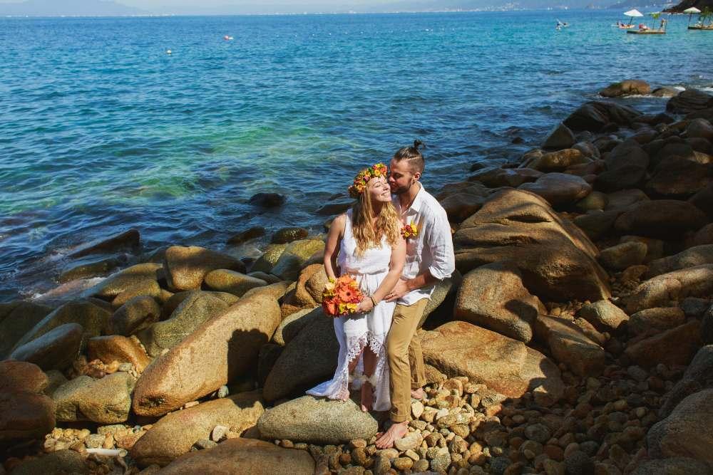 Couple Enjoying the Barefoot Wedding Package at Las Caletas Beach Venue