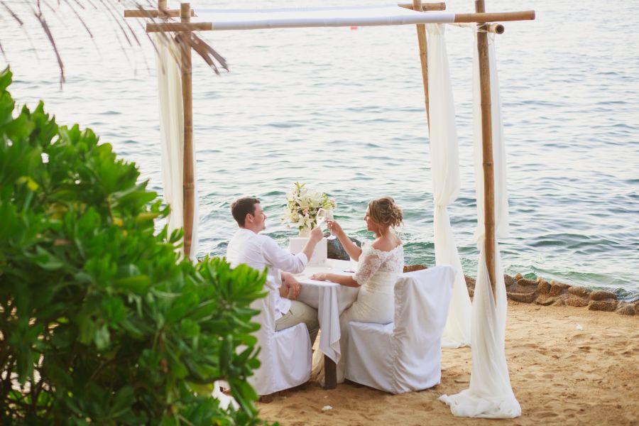 Couple Enjoying Oceanside Elopement Dinner with Barefoot Package at Las Caletas