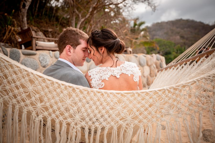 Couple Sitting in Hammock After Small Wedding Celebration at Las Caletas with the Barefoot Package