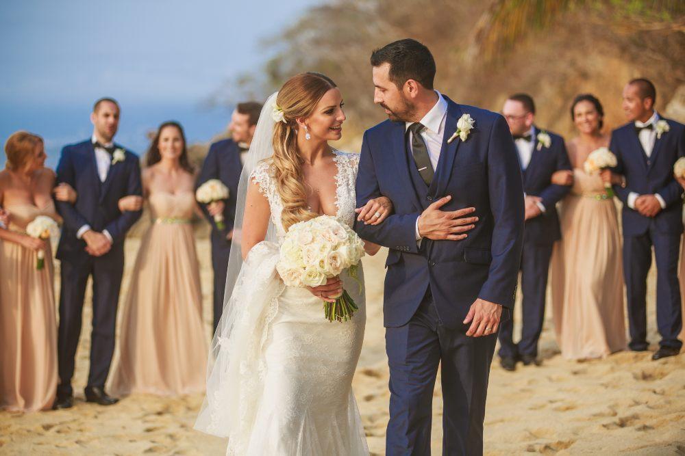 Couple Enjoying their Premier Package Beach Wedding at Las Caletas